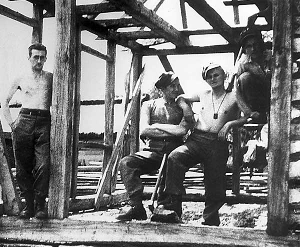 this photo made available Thursday, June 21, 2001 from Italy&#39;s &#34;Il Giornale&#34; newspaper, a 19-year old Karol Wojtyla, later to become Pope John Paul II, second from right, embraces an unidentified colleague during the construction of a military camp building in July 1939 in Western Ukraine, then eastern Poland. Two months before the outbreak of World War II in Europe, Wojtyla, according to biographers, attended a military training camp in Western Ukraine, then eastern Poland, not far from wherehe will visit during his upcoming pilgrimage to Ukraine starting Saturday, June 23, 2001. <span class=meta>( &#40;AP Photo&#47;Il Giornale, Adam Gatty-Kostyal&#41;)</span>